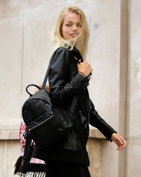 black bomber jacket with backpack and slim jeans