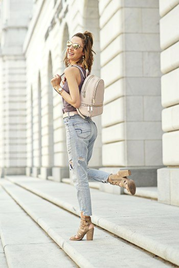 gray tank top with boyfriend jeans and light pink leather backpack handbag