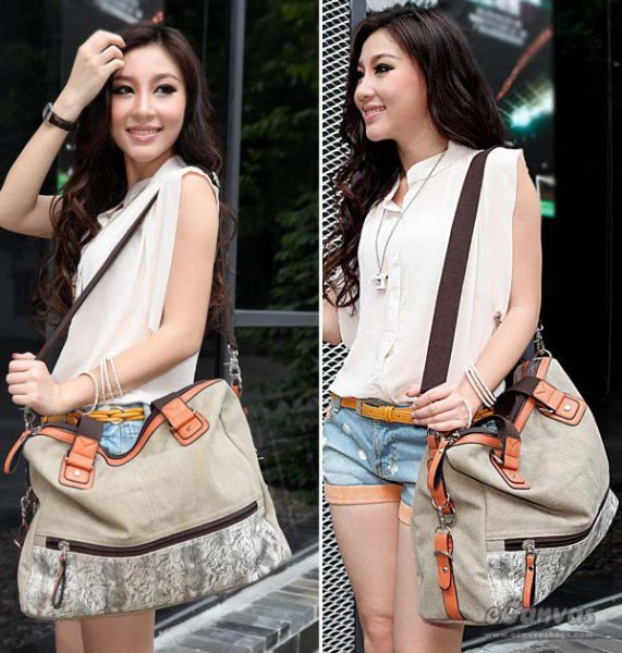 white sleeveless blouse with blue denim shorts and light gray messenger bag