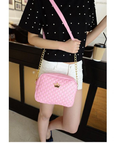 black polka dot tee with white mini-denim shorts and blush leather shoulder bag