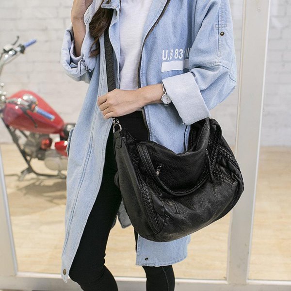 long sleeve jacket with black skinny jeans and leather shoulder bag