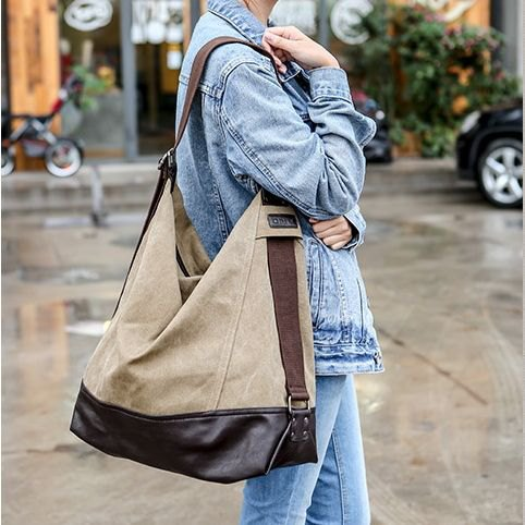 denim jacket with jeans and beige large messenger bag