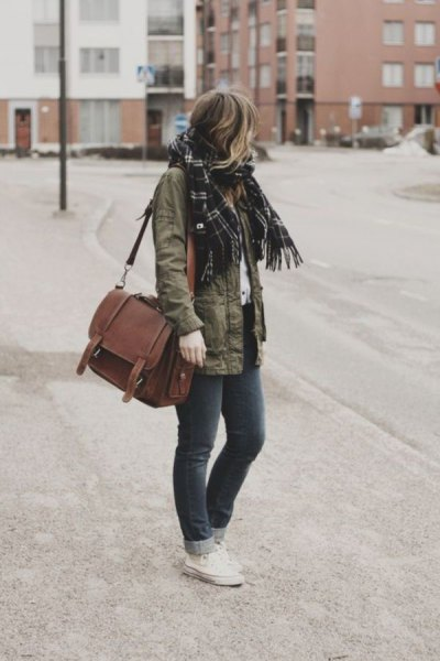 military jacket with black checkered scarf and brown suede bag