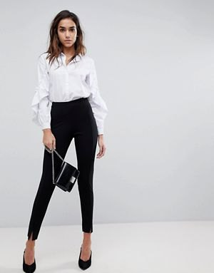white wide long sleeve button up shirt with black chino joggers