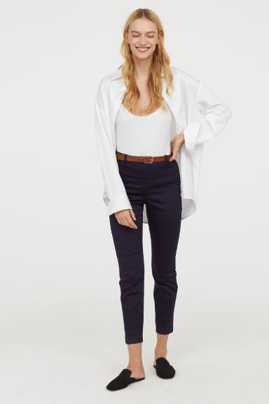 white scoop neck top with oversized shirt and cropped chinos