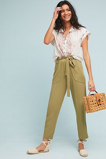 white sleeveless blouse with green cropped chinos