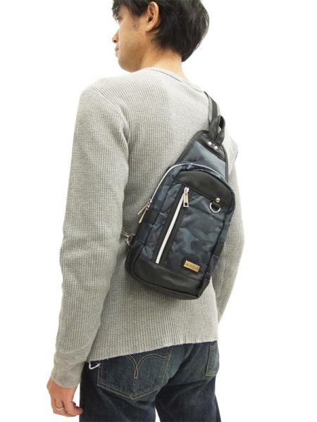 light gray ribbed sweater with camo bag