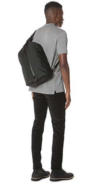 gray polo shirt with black skinny jeans and lift bag