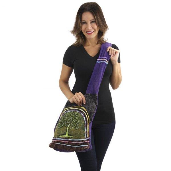 black v-neck tee with skinny jeans and stem printed blue sling bag
