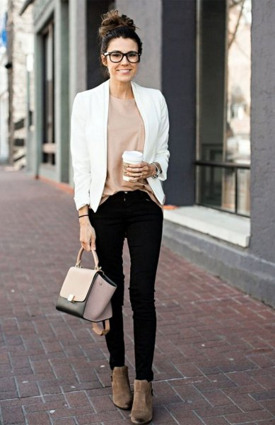 white casual blazer with pink top and black skinny jeans