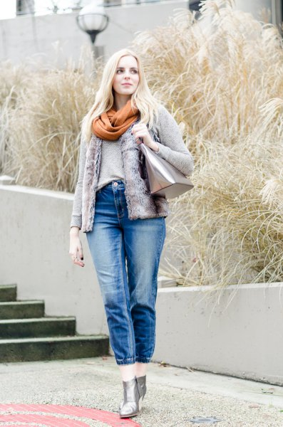 denim jacket with green scarf and cropped blue jeans