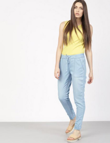 yellow sleeveless top with blue waist with high waist jogging pants