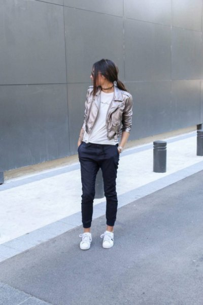 silver blazer with black cropped jogging jeans and white sneakers