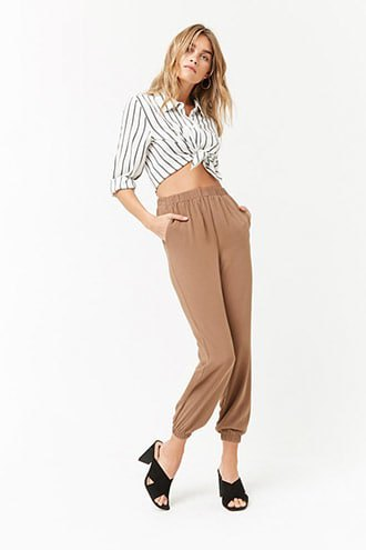 gray and white vertical striped buttoned up shirt with green pants