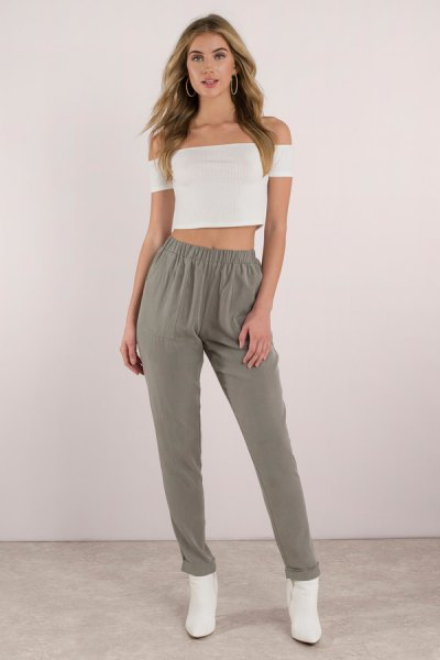 white from the shoulder crop with green elastic khaki pants at the waist