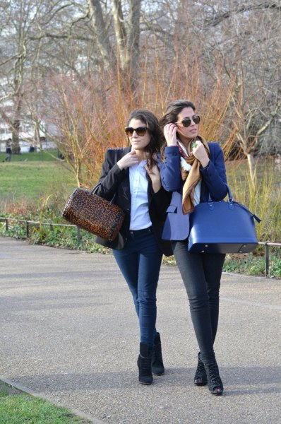 blue blazer with white blouse and navy purse