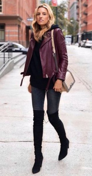 burgundy jacket with black sweater and high thigh boots
