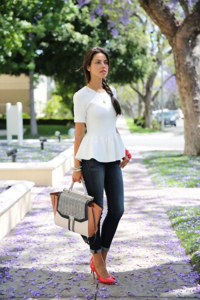 white rolled sleeveless top with cuffed skinny jeans