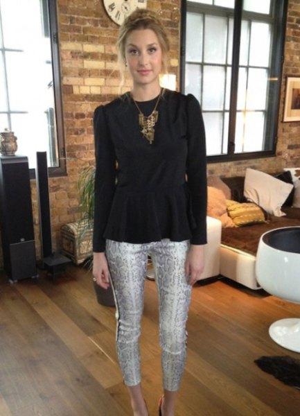 black peplum top with white silky printed cropped skinny pants