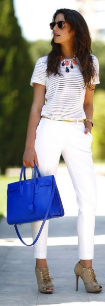 striped tee with white chinos and royal blue leather bag