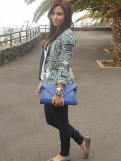 gray printed blazer with blue leather clutch bag