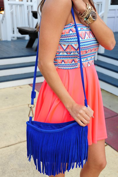 tribal printed pink mini pleated dress with royal blue fringe bag