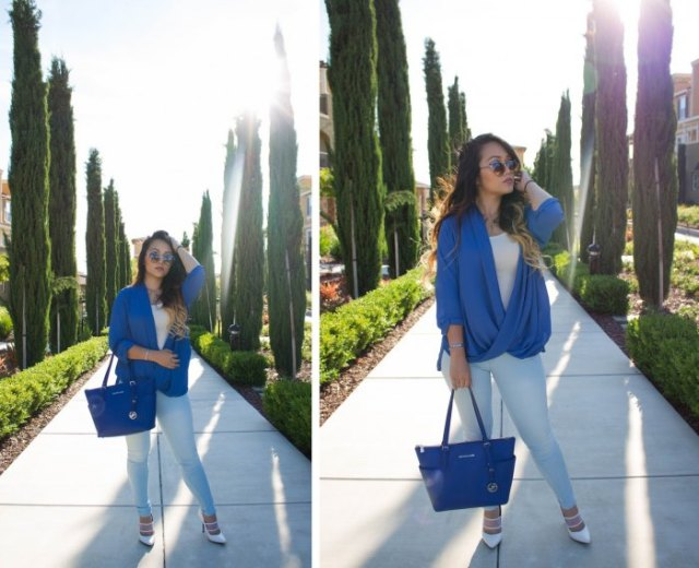 royal blue leather bag with matching draped top and white jeans
