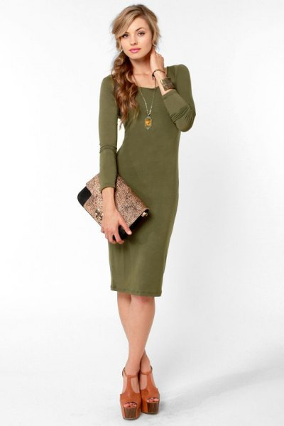 green waist dress with necklace with soft clutch bag