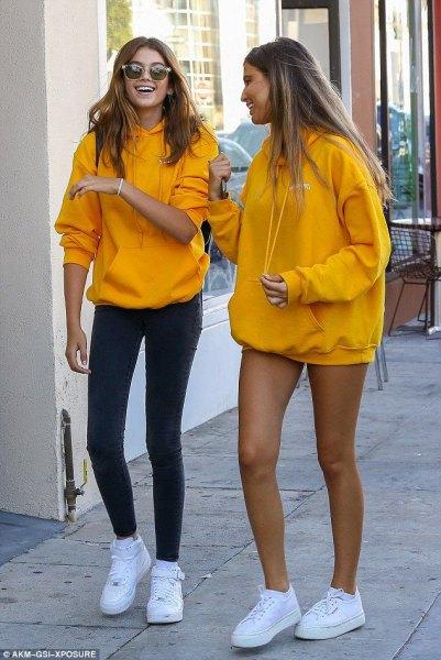 oversized mustard yellow hoodie with super mini denim shorts