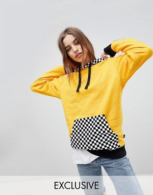 mustard yellow and checkered hoodie with blue jeans