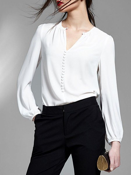 white v-neck blouse with black high skinny jeans