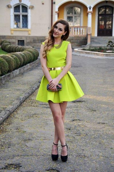 lime green sleeveless miniskirt dress with gold belt