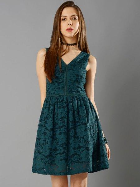 deep green sleeveless mini-skater dress with black choker