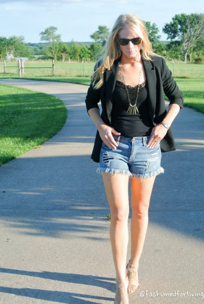 black lace vest with blazer and mini-denim shorts
