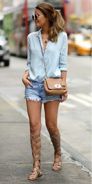 light blue button up shirt with denim shorts and gladiator sandals