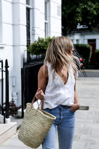white v-shirt with blue jeans and straw bag