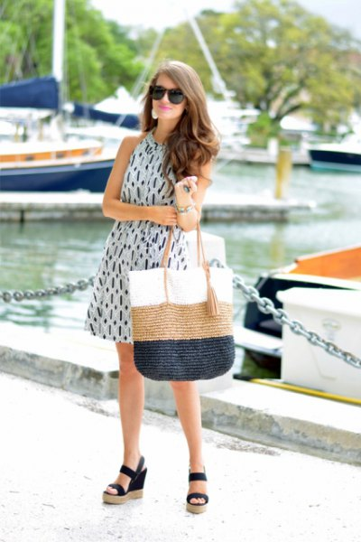 mini pink swing dress with color block straw bag