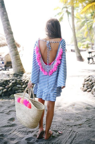 blue and white low back mini shirt dress with straw bag