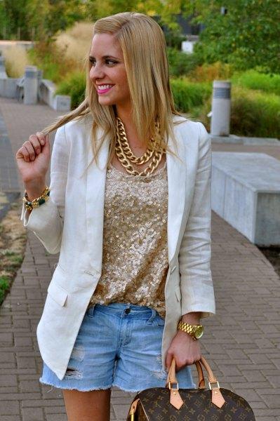 pink gold metallic blouse with white blazer and light blue denim shorts