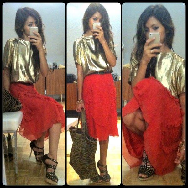 gold metallic short sleeve t-shirt with red midi skirt