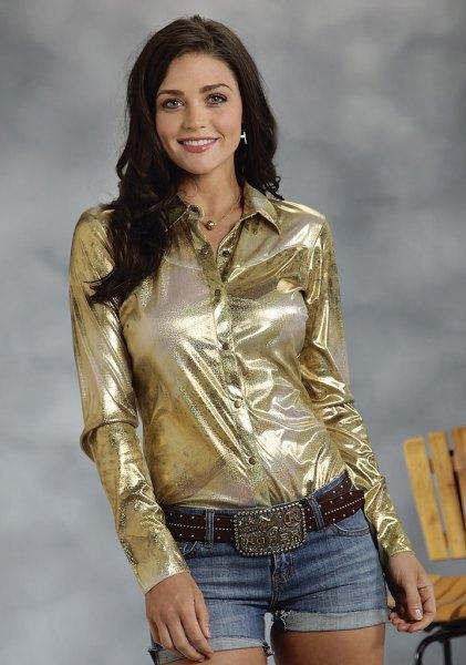 gold metallic shirt with black belt and denim cuffed shorts