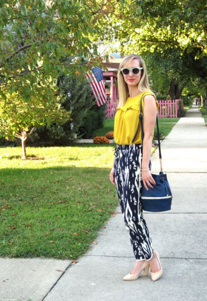 mustard yellow sleeveless top with black and white printed casual fit pants