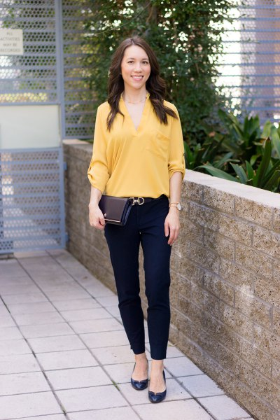 yellow v-neck blouse with black chinos and flats