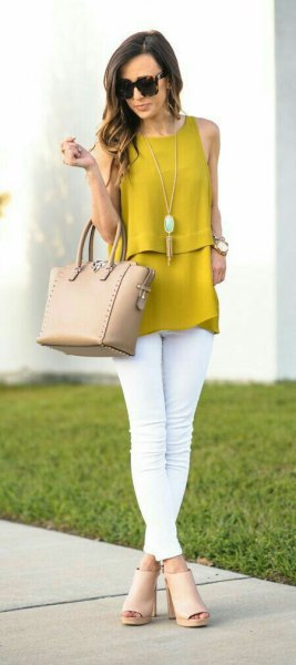 sleeveless top with mustard with white skinny jeans and red open toe boots