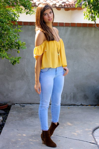 from a yellow top with sky blue jeans