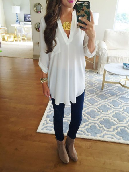 white tunic v-top with gray suede ankle shoes