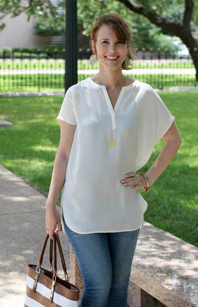 short-sleeved white v-neck blouse with blue jeans