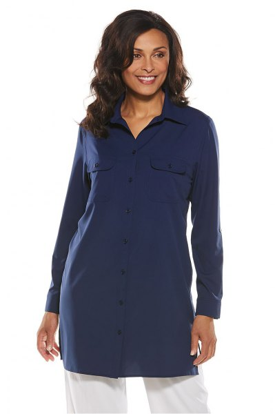 navy blue tunic shirt with white jeans with wide legs