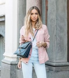 pink jacket with white tee and light blue mom jeans