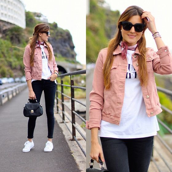 pink denim jacket with white print tee and black skinny jeans